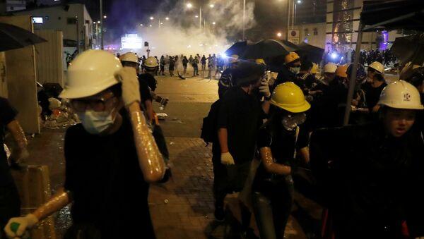 Manifestantes en las protestas de Hong Kong - Sputnik Mundo