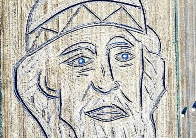 Retrato de San Vladímir dibujado en campo con tractor