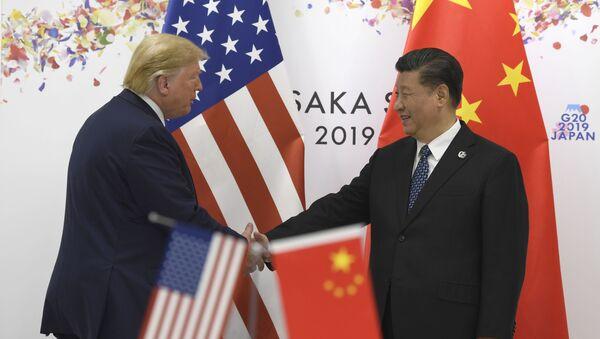 Donald Trump y Xi Jinping durante la cumbre del G20 en Osaka  - Sputnik Mundo