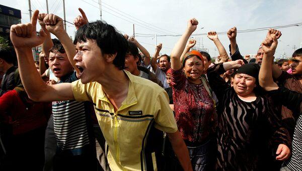 Las protestas étnicas en Xinjuang, región noroccidental de China - Sputnik Mundo