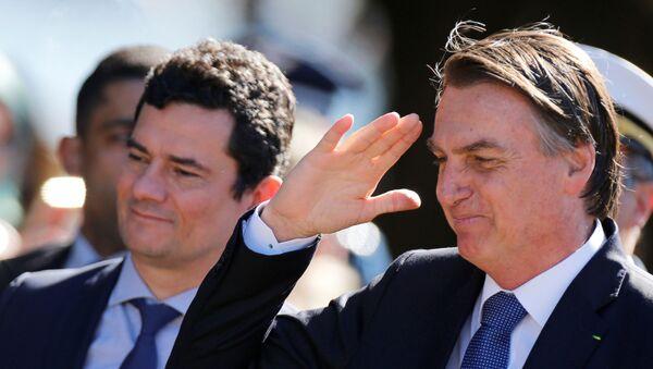 El presidente brasileño, Jair Bolsonaro, y el ministro de Justicia de Brasil, el juez Sérgio Moro - Sputnik Mundo