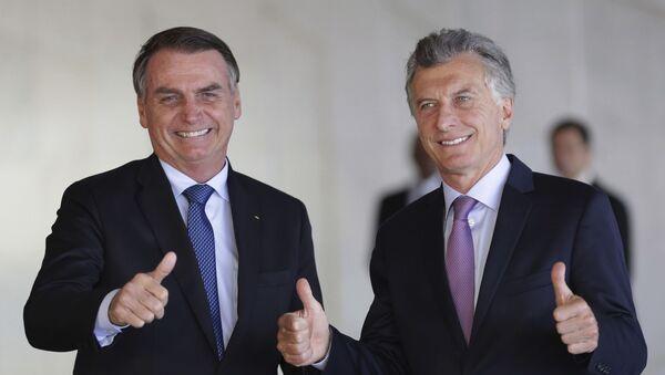 El presidente de Brasil, Jair Bolsonaro, y su homólogo argentino, Mauricio Macri - Sputnik Mundo