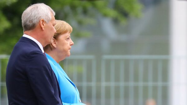 La canciller alemana, Angela Merkel, y el primer ministro finlandés, Antti Rinne - Sputnik Mundo