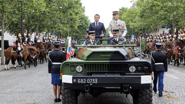 Emmanuel Macron, presidente de Francia en la fiesta nacional de la Toma de la Bastilla - Sputnik Mundo
