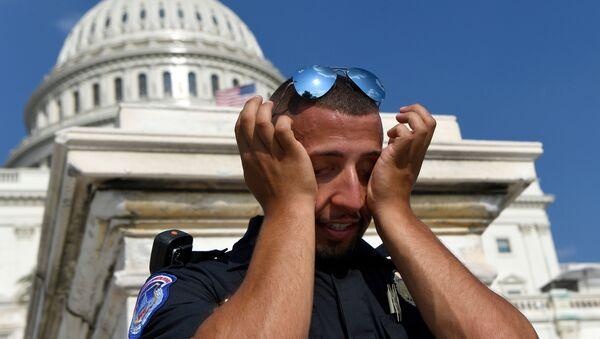 Policía suda durante la ola de calor que afecta EEUU (archivo) - Sputnik Mundo