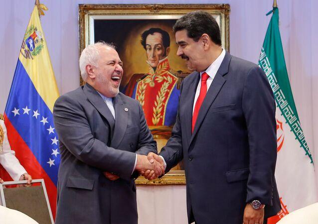 El Ministro de Relaciones Exteriores de Irán, Mohammad Javad Zarif, junto al presidente venezolano, Nicolás Maduro