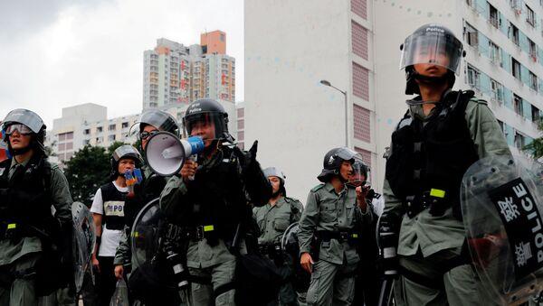 La policía en las protestas de Hong Kong - Sputnik Mundo