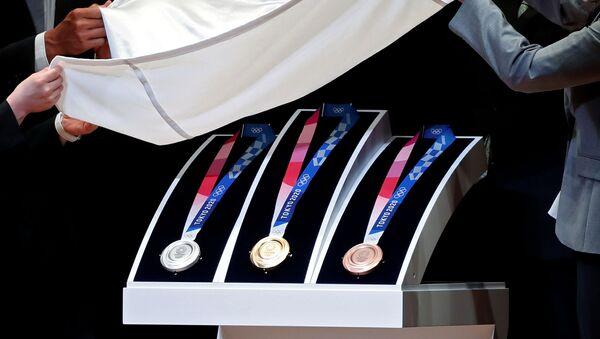 Las medallas de los Juegos Olímpicos de Tokio 2020 - Sputnik Mundo