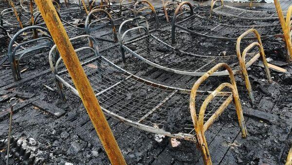 Consecuencias del incendio en un campamento del este de Rusia - Sputnik Mundo