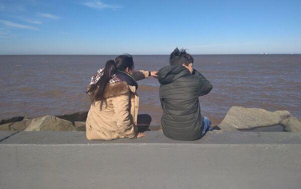 Participantes del taller Conociendo Montevideo en la rambla del Río de la Plata - Sputnik Mundo