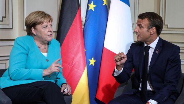 Angela Merkel, canciller de Alemania, y Emmanuel Macron,  el presidente de Francia - Sputnik Mundo