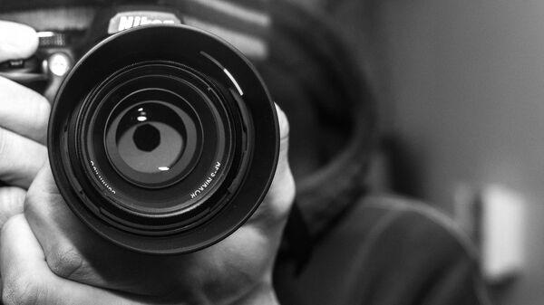 Un fotógrafo (imagen referencial) - Sputnik Mundo