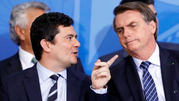 El ministro de Justicia de Brasil Sergio Moro y el presidente brasileño Jair Bolsonaro - Sputnik Mundo