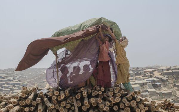 Una de las fotos ganadoras del gran premio del concurso Andréi Stenin. Serie 'Los miserables y tierra' por Gabriele Cecconi, Italia - Sputnik Mundo