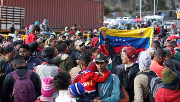 Venezolanos en la frontera de Ecuador - Sputnik Mundo