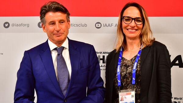 Ximena Restrepo, vicepresidenta de la Asociación Internacional de Federaciones de Atletismo junto al presidente de la Asociación, Sebastian Coe - Sputnik Mundo
