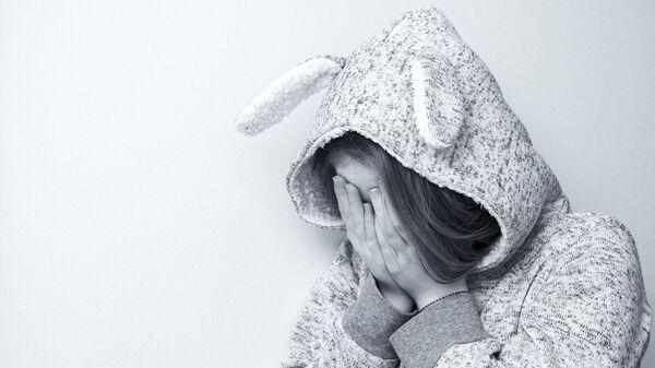 Una niña llorando (imagen referencial) - Sputnik Mundo