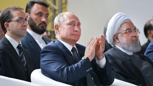 Los presidentes de Rusia e Irán, Vladímir Putin y Hasan Rohaní - Sputnik Mundo