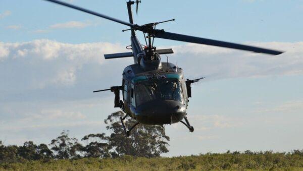Bell UH-1H Huey, de la Fuerza Aérea Uruguaya, equipado con dos ametralladoras - Sputnik Mundo