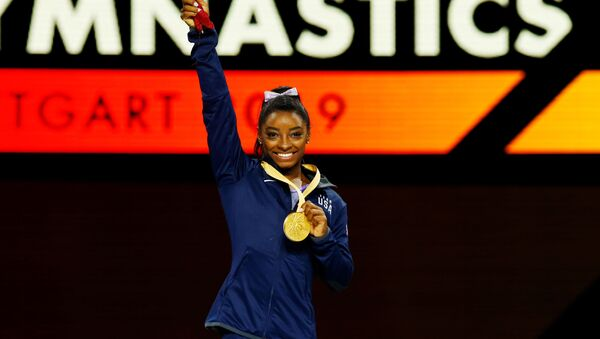 Simone Biles, gimnasta estadounidense - Sputnik Mundo