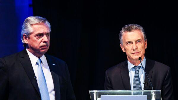 Alberto Fernández y Mauricio Macri durante el primer debate presidencial de 2019 en Argentina - Sputnik Mundo