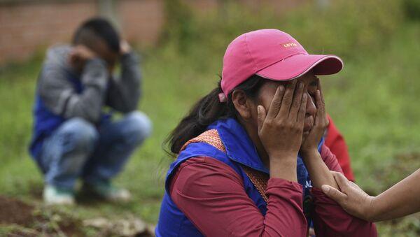 Familiares de los fallecidos durante la masacre del Cauca (Colombia), el 31 de octubre de 2019 - Sputnik Mundo