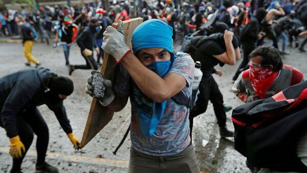 Protestas en Santiago de Chile - Sputnik Mundo