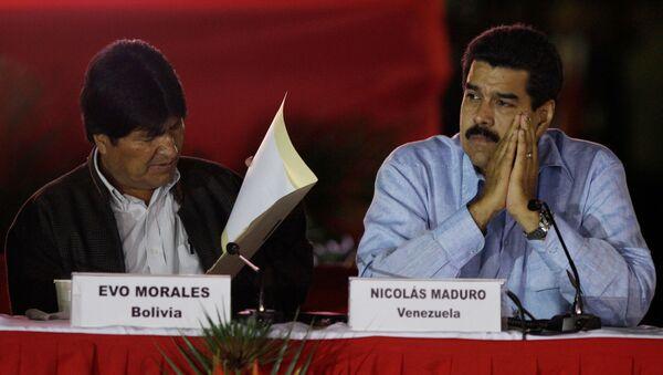 Evo Morales, de Bolivia, y Nicolás Maduro, durante una cumbre del ALBA en 2012 - Sputnik Mundo