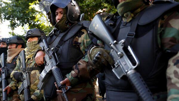 Efectivos de la Policía de Bolivia en una ceremonia tras la salida de Evo Morales - Sputnik Mundo