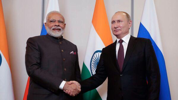 El presidente ruso, Vladímir Putin, yel primer ministro de la India, Narendra Modi - Sputnik Mundo