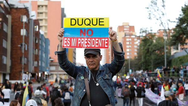 Manifestación contra el presidente de Colombia, Ivan Duque, en Bogotá, el 25 de noviembre de 2019 - Sputnik Mundo