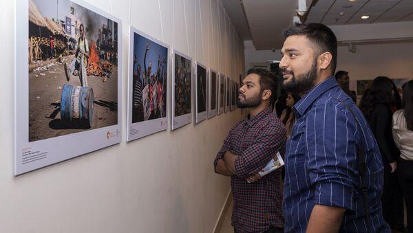 La inauguración de la exposición de fotos de ganadores del concurso Andréi Stenin 2019 en Nueva Delhi  - Sputnik Mundo