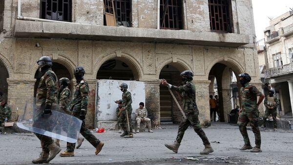 Fuerzas de Seguridad durante las protestas en Irak - Sputnik Mundo