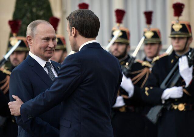 El presidente ruso, Vladímir Putin con su homólogo francés, Emmanuel Macron en la Cumbre del Cuarteto de Normandía en París