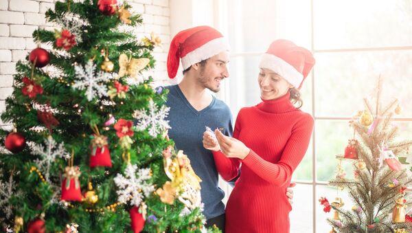 Una pareja en la Navidad - Sputnik Mundo