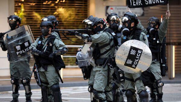 La Policía de Hong Kong durante las manifestaciones - Sputnik Mundo