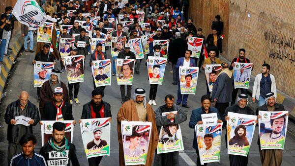 Retratos de los manifestantes muertos en Irak - Sputnik Mundo