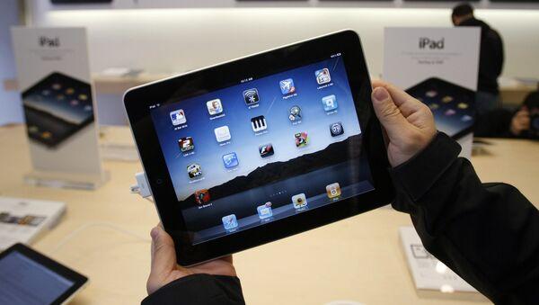 El primer día de ventas de iPad de Apple (2010) - Sputnik Mundo