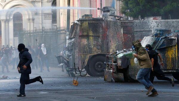 Ola de protestas en América latina - Sputnik Mundo