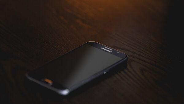 Un teléfono de Samsung - Sputnik Mundo