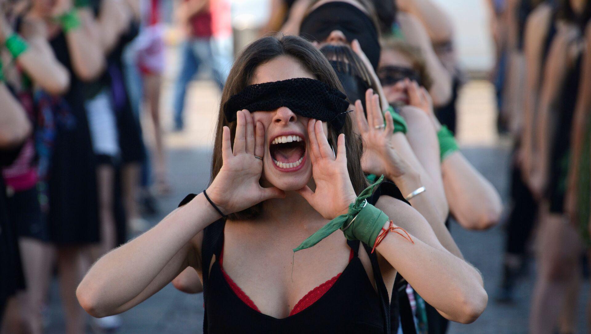 Una marcha contra la violencia de género en Argentina  - Sputnik Mundo, 1920, 25.12.2019