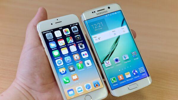 Teléfonos móviles de Apple y Samsung - Sputnik Mundo