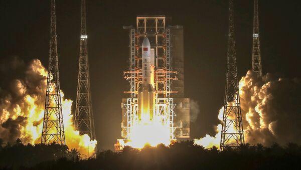 Lanzamiento del cohete portador Larga Marcha 5 - Sputnik Mundo