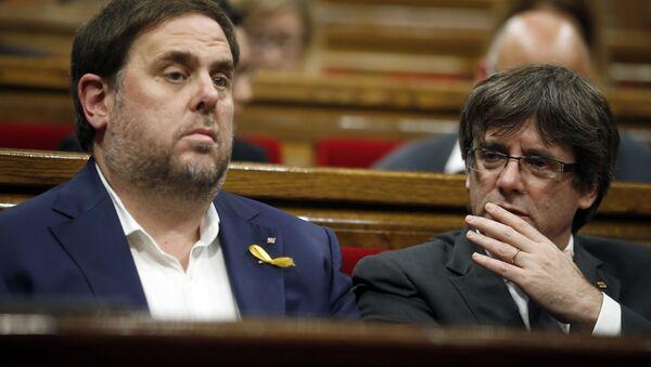 El expresidente catalán Carles Puigdemont y el exvicepresidente Oriol Junqueras - Sputnik Mundo