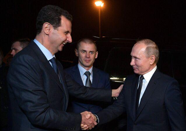 Bashar Asad, presidente sirio, recibe a su homólogo ruso, Vladímir Putin, en Damasco