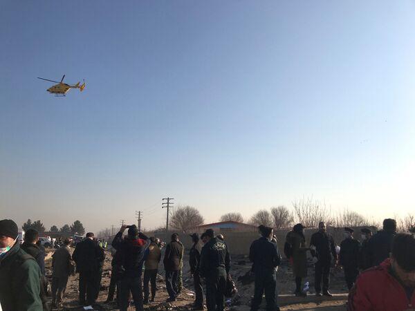 Los rescatistas en el lugar de la catástrofe aérea en Irán - Sputnik Mundo