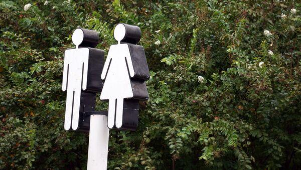 Figuras de un hombre y una mujer - Sputnik Mundo