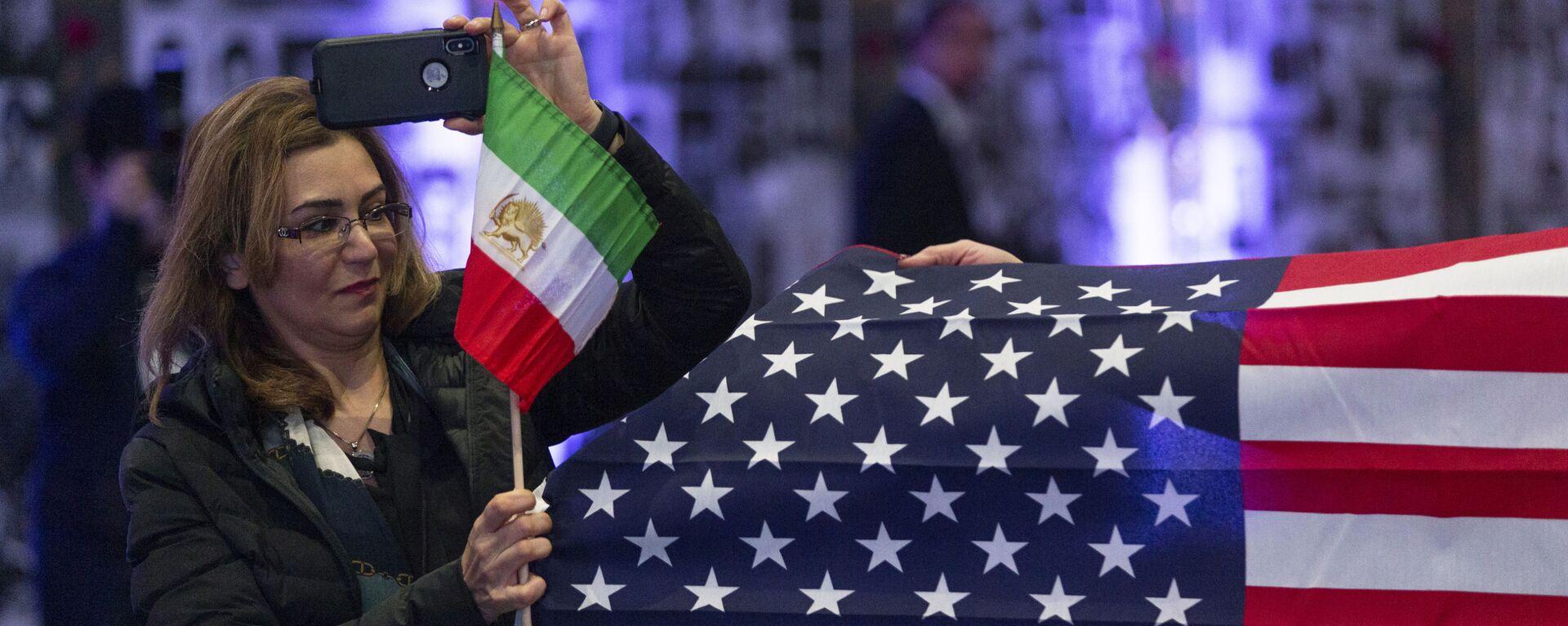 Banderas de EEUU e Irán - Sputnik Mundo, 1920, 07.04.2021