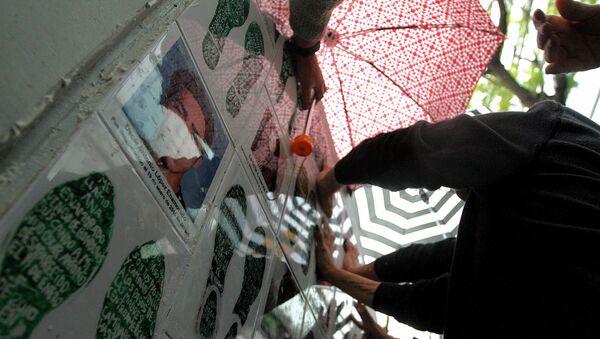 Memorial por los desaparecidos frente a la Fiscalía de México - Sputnik Mundo