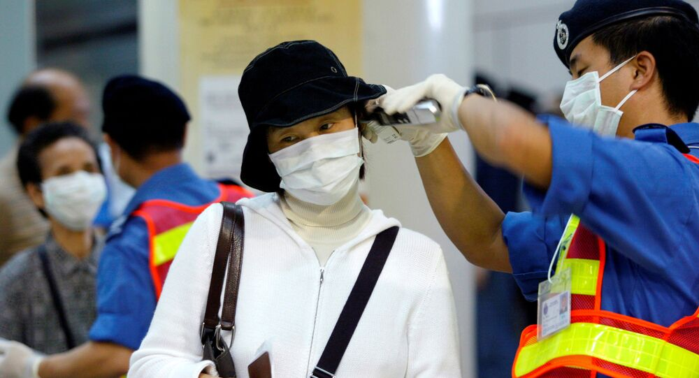 Una mujer china con máscara a causa del coronavirus en Hong Kong